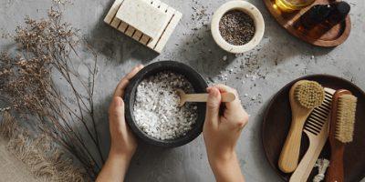 Woman making homemade bath salt with lavender
